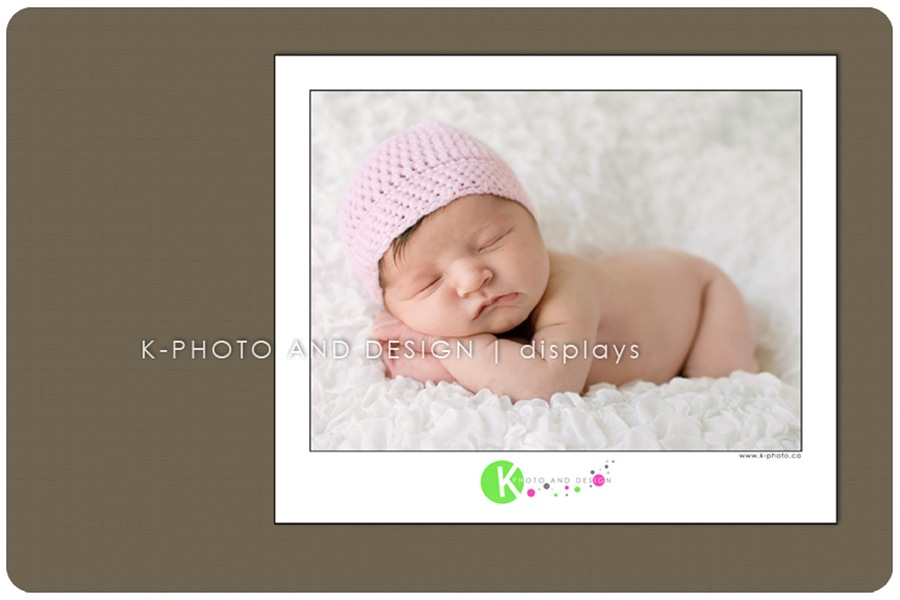 framed baby with hat photo