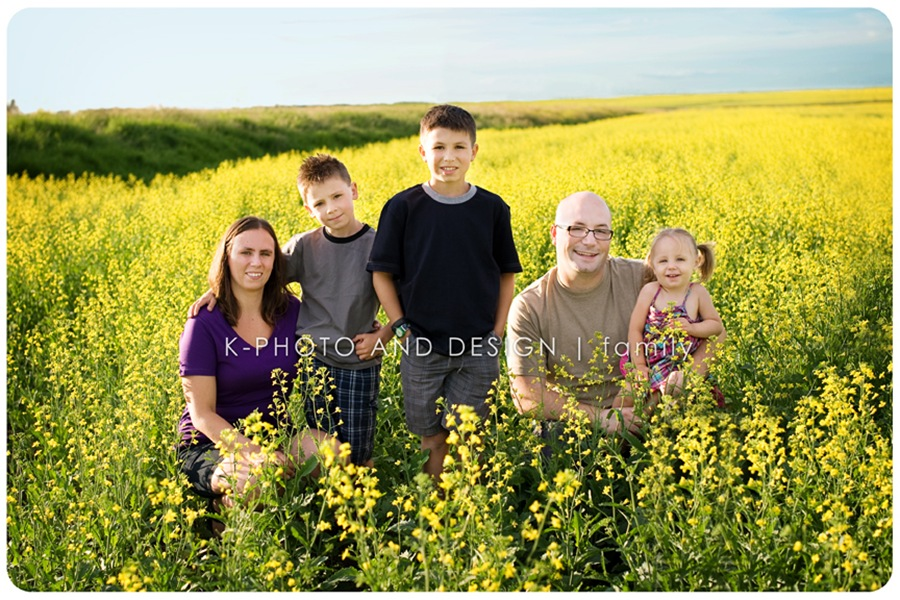 family in canola field